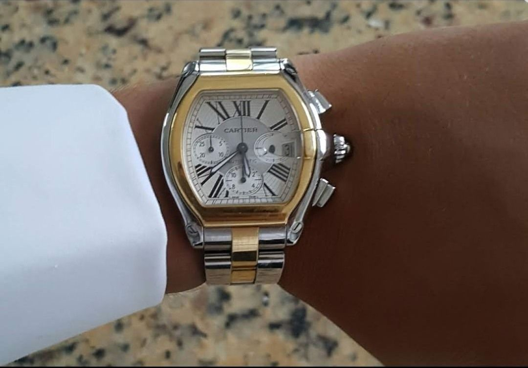 Cartier watch worn by a person
