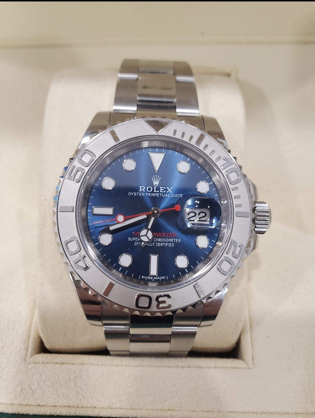 blue Rolex watch with silver strap
